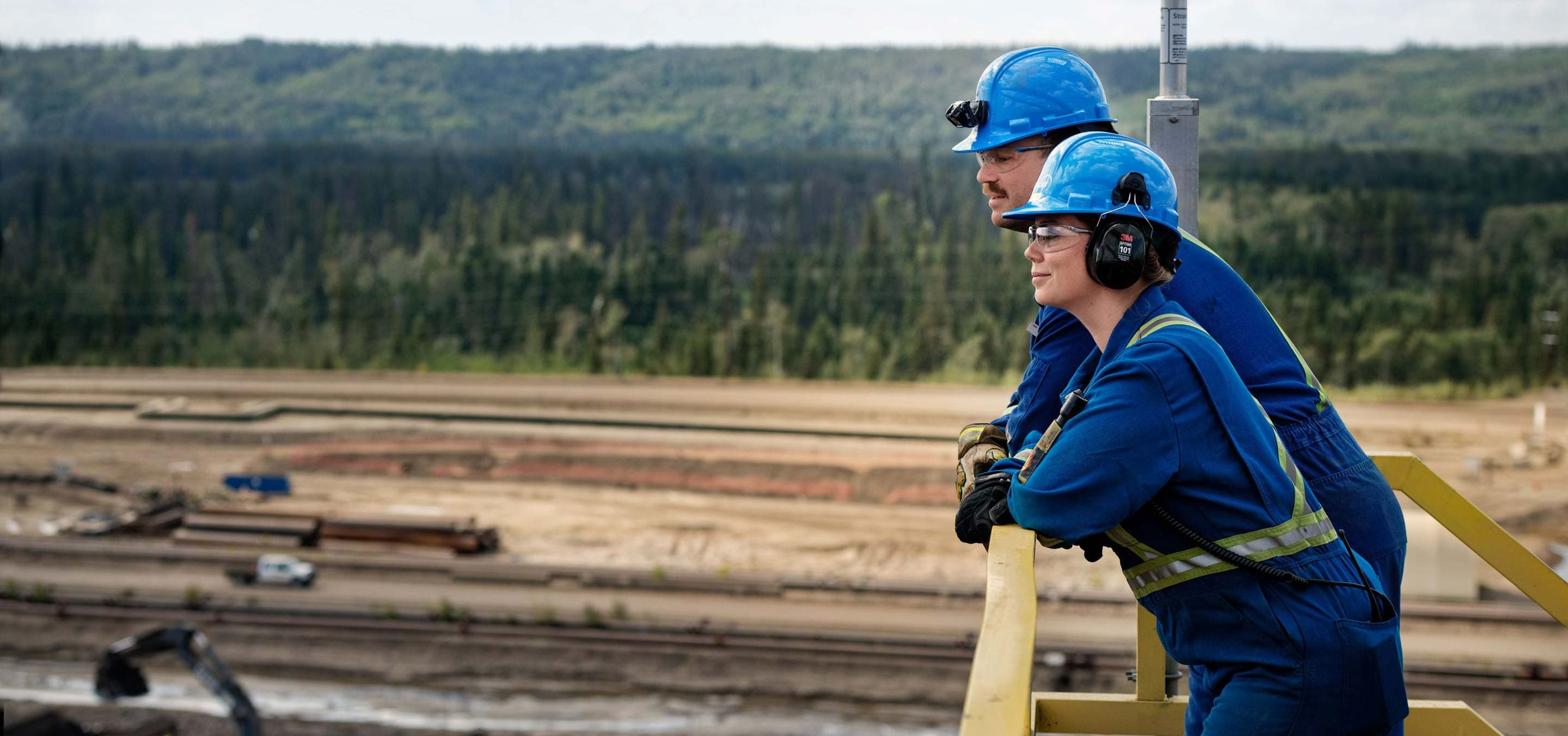 Two workers at extraction operations at Suncor's oil sands Base plant.