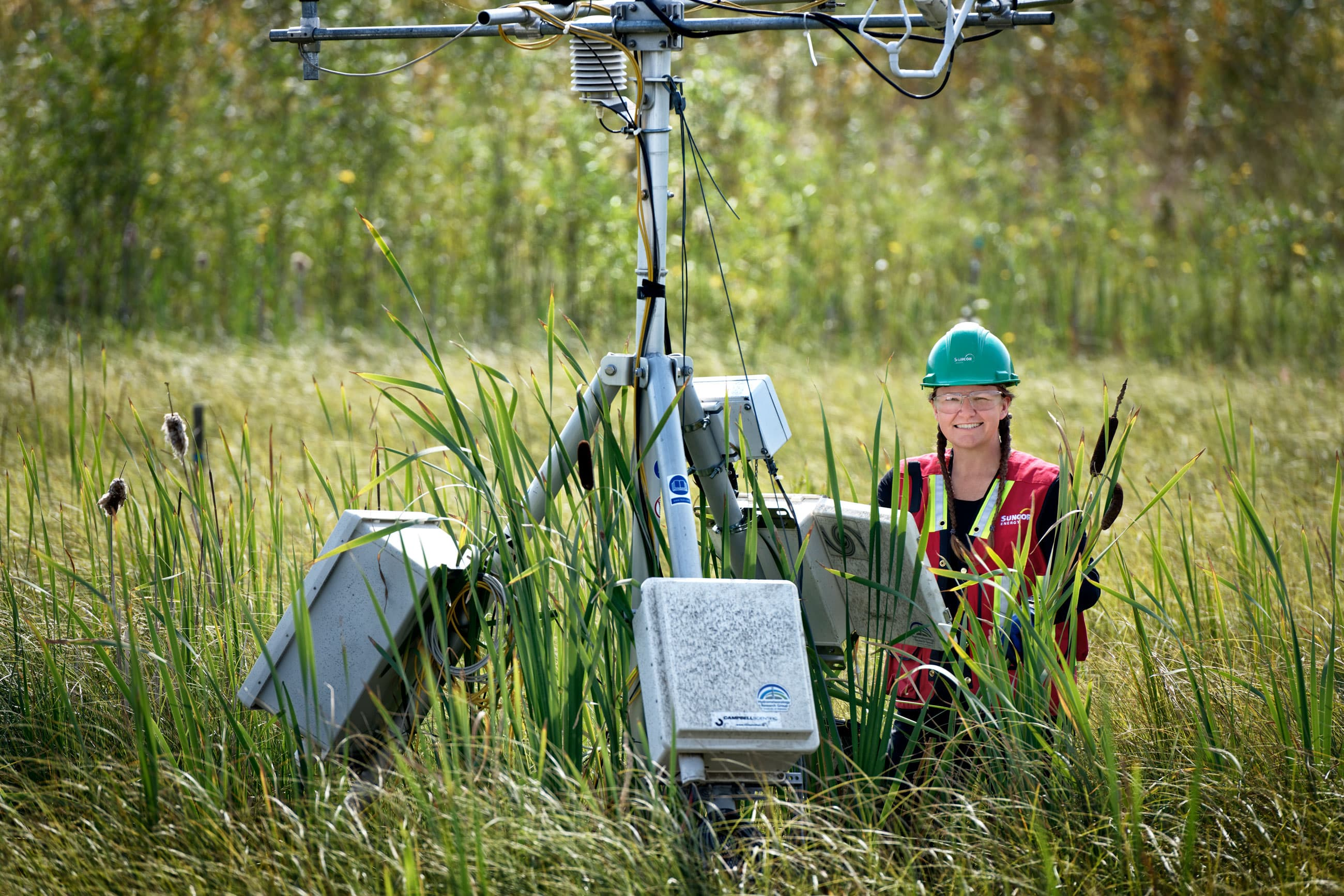 A Suncor air quality tester uses her equipment
