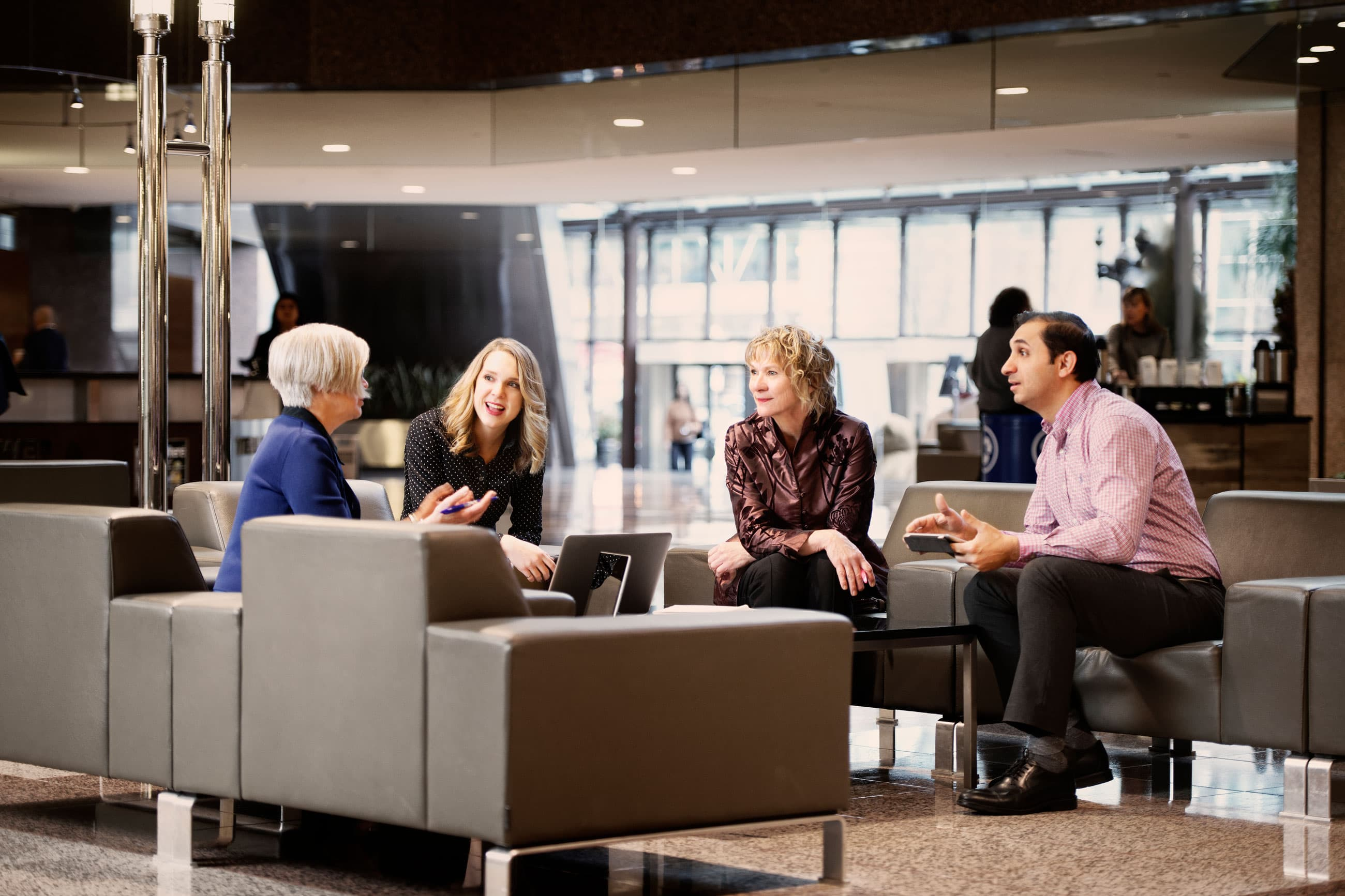 Four employees in the Suncor Energy Centre lobby