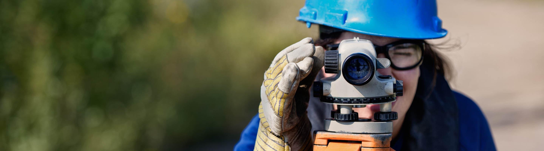 Woman conducts environmental monitoring at Base Plant