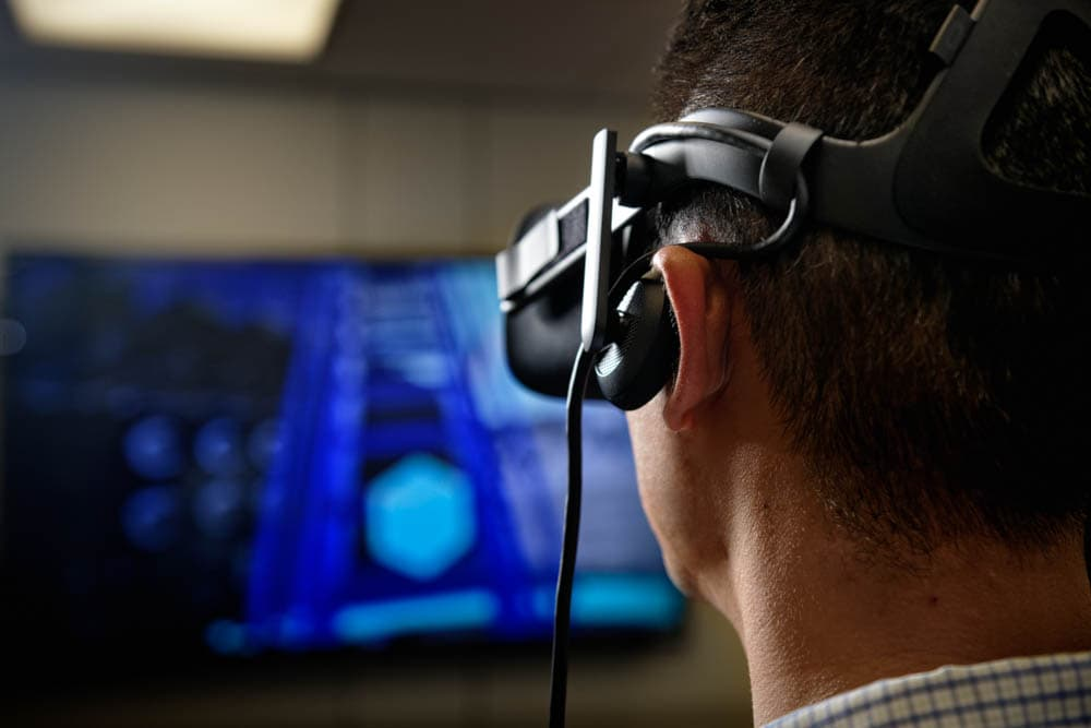 Employee wearing a virtual reality headset