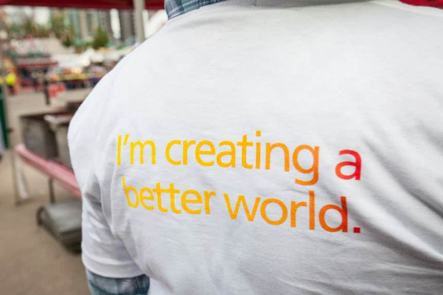 White t shirt with writing on it that says I'm creating a better world