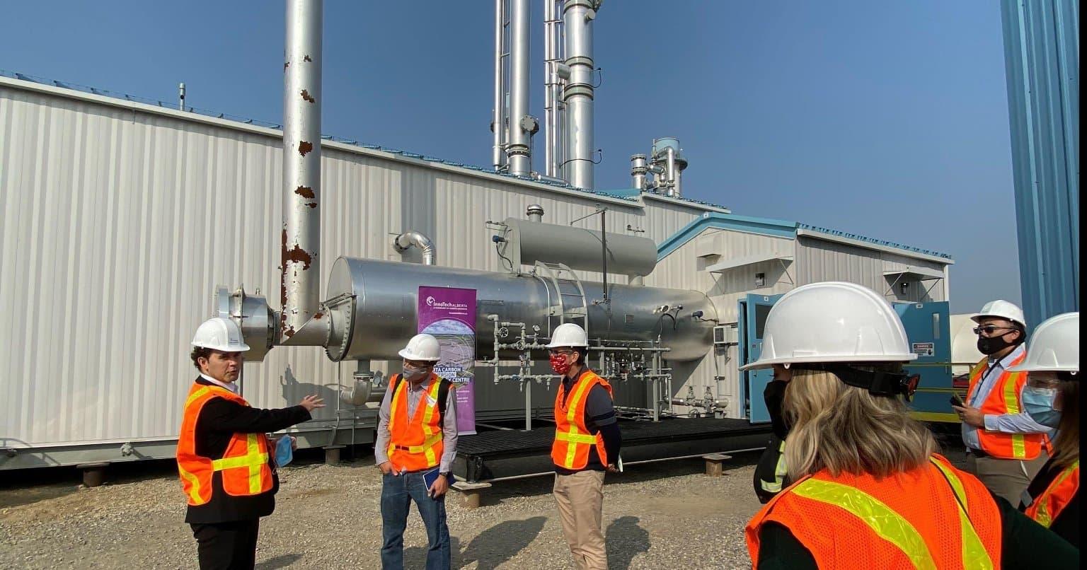 Tour visitors outside the carbon capture unit at the ACCTC