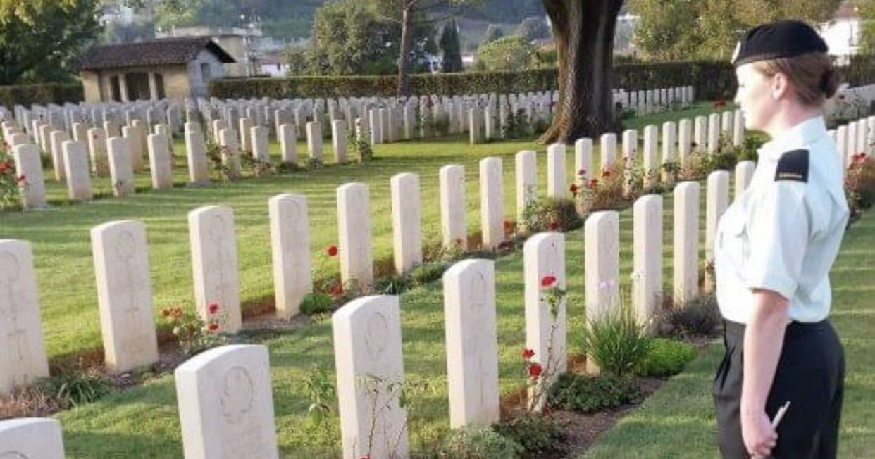 Corporal Larter at a gravesite in Italy paying respects to fallen Canadian soldiers