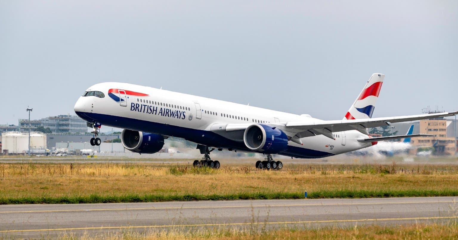 British Airways plane on runway with front wheels lifting off