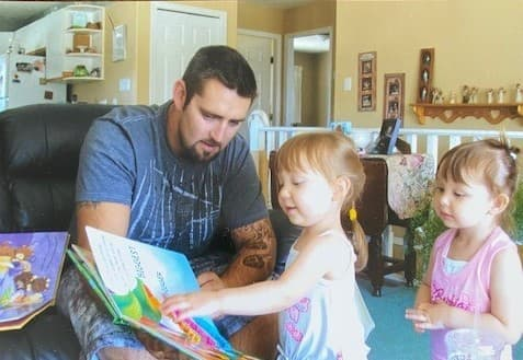 Jeffrey reads to his nieces, who are Indigenous, when they were younger
