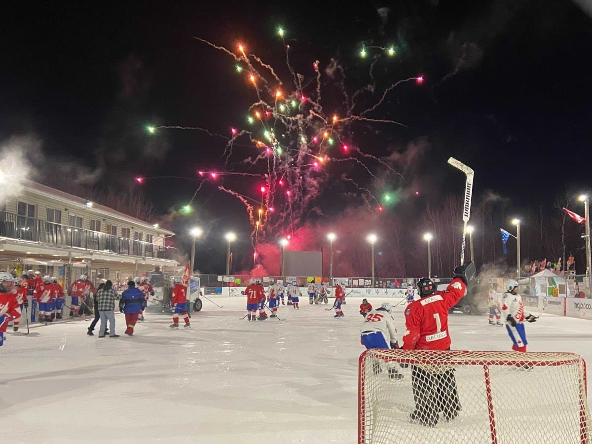 skating rink with fireworks and hockey players