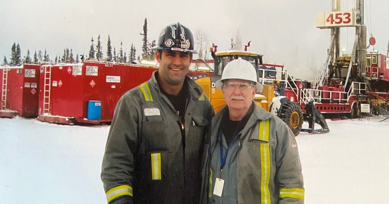 two men in personal protective equipment standing in front of operations