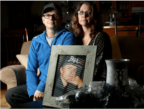 Liam and Dana Parkes with a photo of their son Tristan.