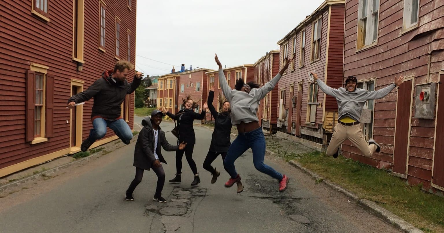 MBA students jumping for joy