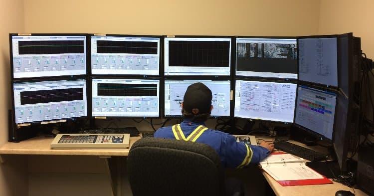 Suncor worker behind computer screens
